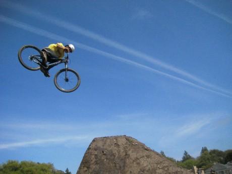 A rider flies through the air during the Jump Jam during the 2012 edition of the Santa Cruz Mountain Bike Festival in Aptos, Calif. (Christina Gullickson/Sentinel)